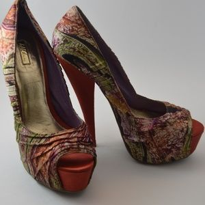 Wild Pair Swirly Peep Toe Pumps